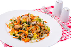 Salad with mussels and vegetables on plate, white background Royalty Free Stock Photography