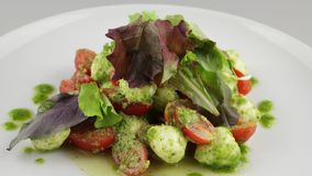 Salad Neapolitano with cherry tomatoes and mozzarella stock video