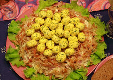 Salad Nest of a wood grouse. With fried potatoes, lettuce, processed cheese, eggs, chicken, field mushrooms, mayonnaise Stock Photos