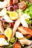 Salad Nicoise with eggs, mackerel, anchovy and tomatoes. Top view Royalty Free Stock Photos