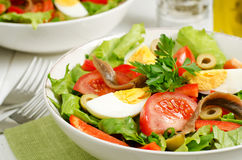 Salad Nicoise. With tomatoes, tuna, eggs, anchovies and olives, close up Stock Photos