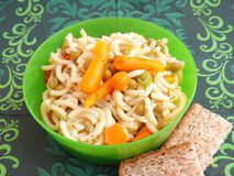 Salad of noodles. A fresh salad of noodles with carrots and peas Stock Photo