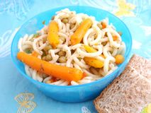 Salad of noodles. A fresh salad of noodles with carrots and peas Royalty Free Stock Photo