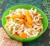 Salad of noodles. A fresh salad of noodles with peas and carrots Stock Photos