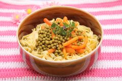 Salad of noodles. A fresh salad of noodles with peas and carrots Stock Image