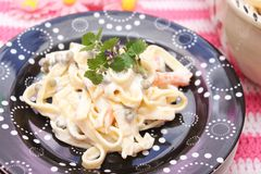 Salad of noodles. A fresh salad of noodles with peas and carrots Royalty Free Stock Photography