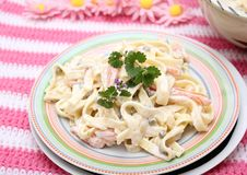Salad of noodles. A fresh salad of noodles with peas and carrots Royalty Free Stock Images