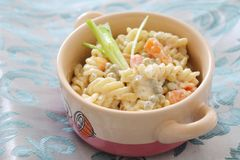 Salad of noodles with peas and carrots. A fresh salad of noodles with peas and carrots Royalty Free Stock Images