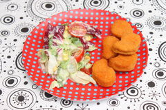 Salad with nuggets Stock Image