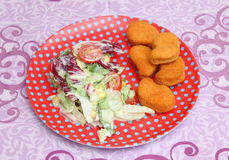 Salad with nuggets Stock Photography