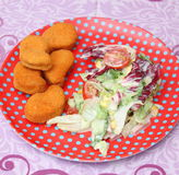 Salad with nuggets Stock Images