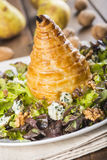 Salad of nut lettuce with a pear in puff pastry Royalty Free Stock Photo
