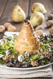 Salad of nut lettuce with a pear in puff pastry Stock Photos