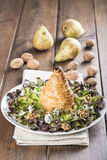 Salad of nut lettuce with a pear in puff pastry Royalty Free Stock Photography