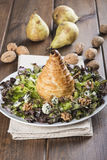Salad of nut lettuce with a pear in puff pastry Stock Images