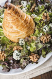 Salad of nut lettuce with a pear in puff pastry Royalty Free Stock Photos