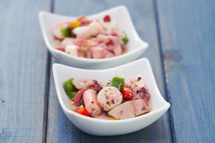 Salad with octopus in bowl Stock Photo