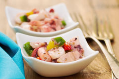 Salad with octopus in bowl Stock Images