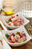 Salad with octopus in bowl Royalty Free Stock Photos