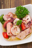 Salad with octopus sea food on small white dish Royalty Free Stock Images