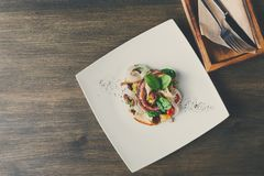 Salad with octopus and vegetables top view Royalty Free Stock Images