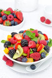 Salad Of Fresh Fruit And Berries In A Bowl Royalty Free Stock Image