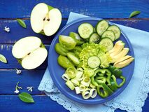 Free Salad Of Green Vegetables And Fruits On Blue Wooden Background Royalty Free Stock Image - 187534446