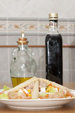 Salad with oil and vinegar Royalty Free Stock Photography