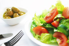 Salad. And Olive dishes on the dinner table Stock Images