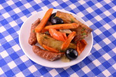 Salad with olives sausage carrot Stock Photography