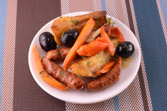 Salad with olives sausage carrot Stock Photo