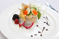 Salad olivier. Traditional salad with caviar and berries Royalty Free Stock Photo