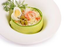 Salad Olivier closeup with eggs and a cucumber royalty free stock image