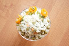 Salad olivier in a glass vase Royalty Free Stock Image