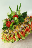 Salad Olivier decorated by flowers Stock Photo