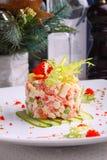 Salad Olivier with salmon, lemon and caviar Royalty Free Stock Photography