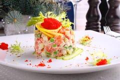 Salad Olivier with salmon, lemon and caviar Royalty Free Stock Photo