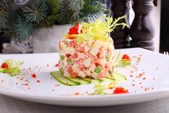 Salad Olivier with salmon, lemon and caviar Stock Photography