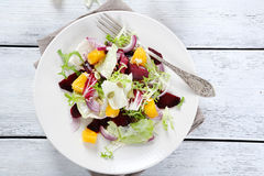 Salad with onions and oranges on a plate Stock Photos