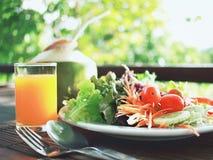 Salad and orange juice Stock Photo