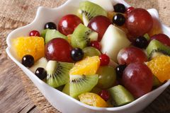 Salad of oranges, kiwi, grapes and berries macro. Horizontal Royalty Free Stock Images