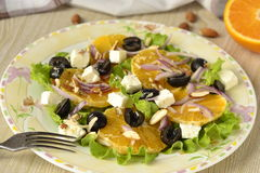 Salad with oranges, olives Stock Images