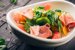 Salad with oranges, spinach and meat Royalty Free Stock Image