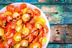 Salad of organic cherry tomatoes with olive oil and balsamic sauce closeup Stock Images