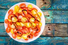 Salad of organic cherry tomatoes with olive oil and balsamic sauce Stock Image