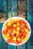 Salad of organic cherry tomatoes with olive oil Stock Photography
