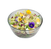 Salad with pansy flowers. Isolated. Stock Photo