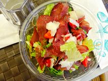 Salad with parma ham top view plate Stock Image