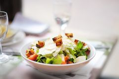 Salad with parmesan cheese and croutons, chicken and tomato Stock Photos