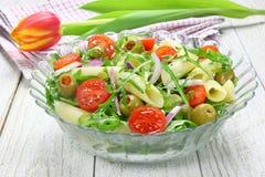 Salad with pasta. Arugula, tomato, onion and green olives Stock Photos